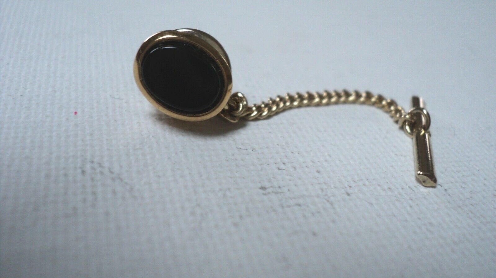 Vintage Goldtone Onyx Black Oval Shaped Tie Tack/Clip With Chain - $8.00
