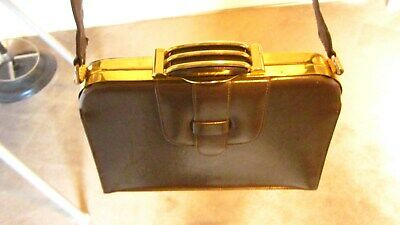 1940s Handbags and Purses History 1940,s fabulous brown /gold boxy little handbag with unusual clasp. $34.84 AT vintagedancer.com