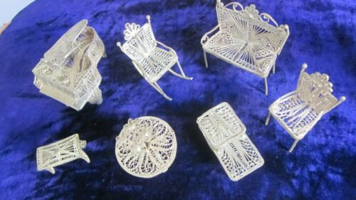 7pce set of doll furniture in silver filligree wire.Piano and stool,table,etc