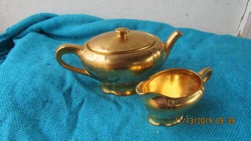 Tiffany & Co New York gold teapot and matching creamer