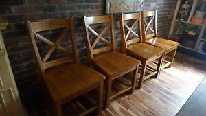 Four wooden dinning chairs