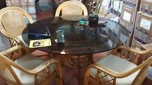 Glass topped cane base dining table and four cane chairs Kippa-ring Redcliffe Area Preview