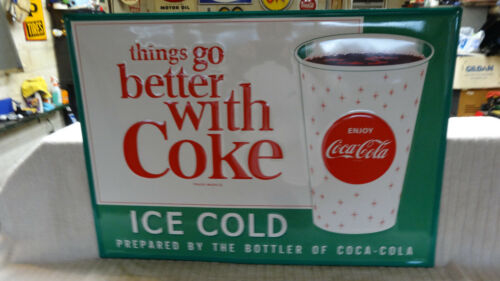 """""""COCA COLA WITH CUP"""" LARGE EMBOSSED METAL ADVERTISING SIGN. MEASURES 28""""x 20"""" AN"""