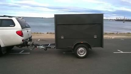 7x5 Enclosed Boxed Trailer  12 months old. With Tool Box, & more.