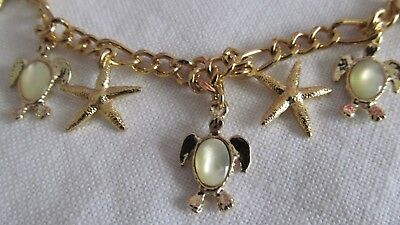 (GOLD TONE STARFISH & MOTHER OF PEARL TURTLES CHARM BRACELET 8