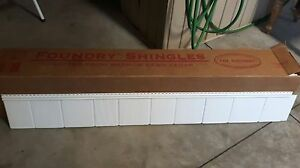 Have 2 boxes of white siding shakes for sale , 100 sqft in each