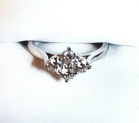 18ct white gold, four stone diamond ring