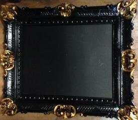 Handmade chalkboard in heavily decorative frame
