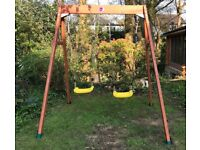 Plum wooden double swing. Brand new. RRP £149.00