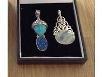 Two unusual silver pendants .Unwanted gift.
