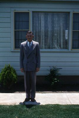 1950s Mens Suits & Sport Coats   50s Suits & Blazers 35mm Slide 1950s Red Border Kodachrome Handsome Man in Suit Outside House $17.99 AT vintagedancer.com