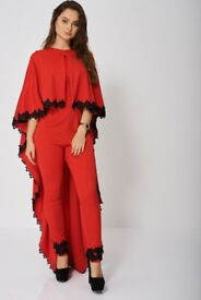 Beautiful all sizes jumpsuit with cape. Really special. All sizes