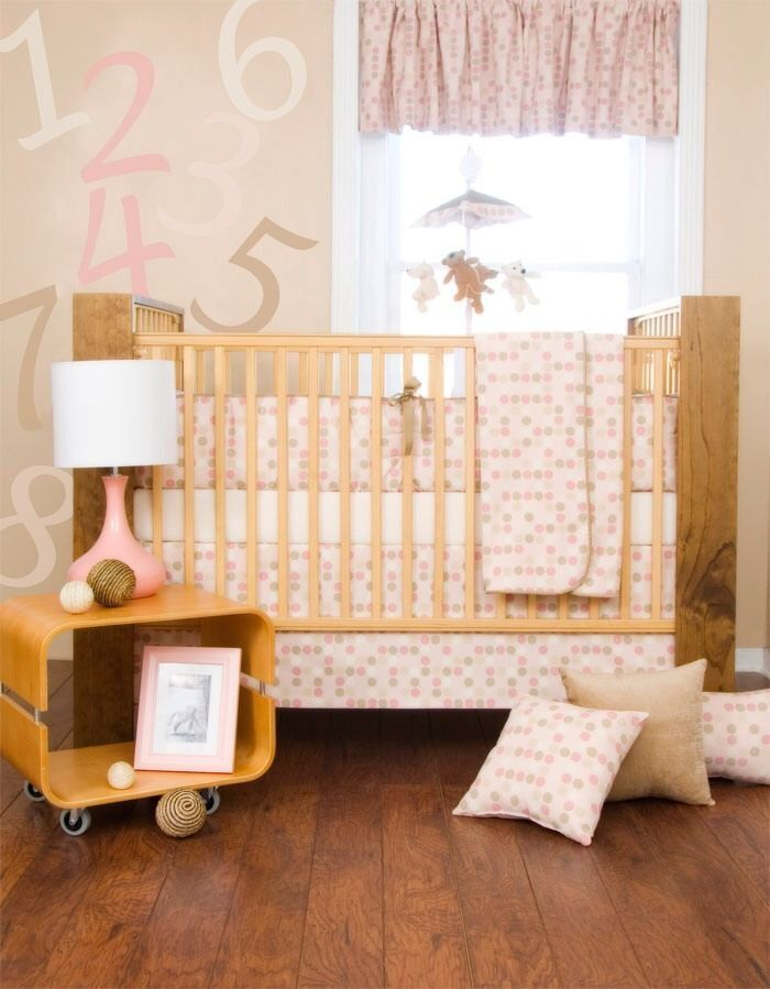 a simple way to bring a modern look and feel to any nursery the glenna jean hopscotch crib bedding set includes four pieces that turn an ordinary standard