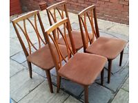 4 dining chairs. G-Plan brand, cushion seats, wood frame. Used condition but still structurally good