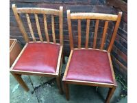 Antique wooden chairs with leather upholstery