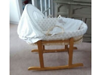 Mother Care Moses basket on rocking stand with mattress, hood and bedding.