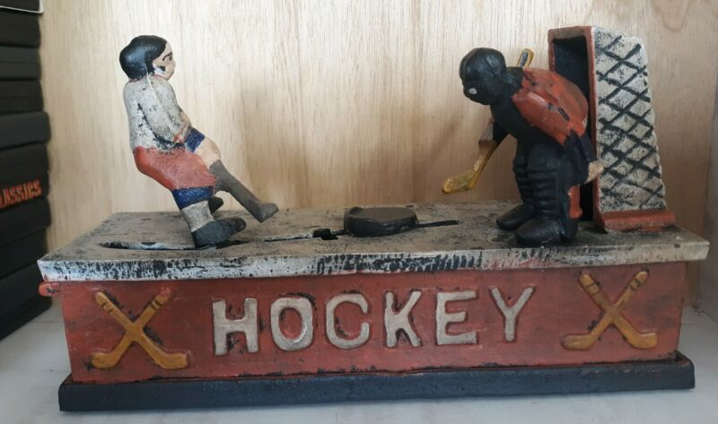 VINTAGE REPRODUCTION HOCKEY MECHANICAL BANK CAST IRON