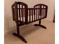 Walnut swinging crib £45
