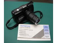 Olympus Mju Zoom 105mm, 35mm film camera, black colour, with strap & instructions.