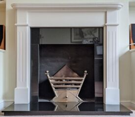 Polished granite fire surround, hearth and wooden mantel