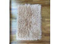 Tan faux sheepskin rug