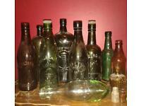 Collection of 12 vintage antique old bottles including beer bottles