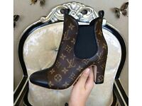 """"""" Louis Vuitton leather boots perfect with bag """""""