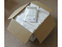 Box of 100 white padded envelopes.
