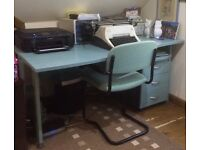 Large desk with three storage drawers and matching chairs