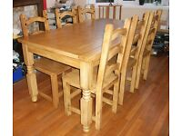 Antique look pine table with moderate decorative distressed look. Complete with 6 pine chairs.