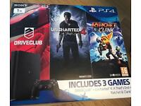 1tb PS4 with 3 games. New in box, never opened
