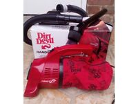 Handheld Dirt Devil vacuum cleaner - small yet powerful - great working condition.