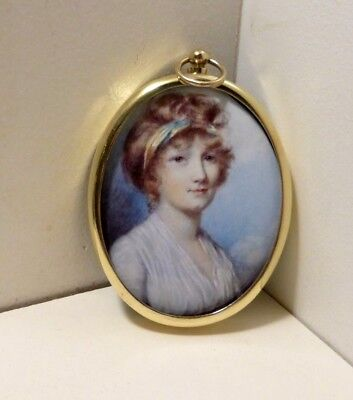 Miniature of a woman with a hair band set in an oval brass bezel