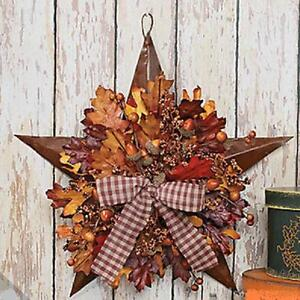 13-Metal-Barn-STAR-with-Autumn-Leaves-Acorns-Berries-and-a-Bow
