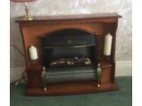 Electric fire and surround wooden fireplace