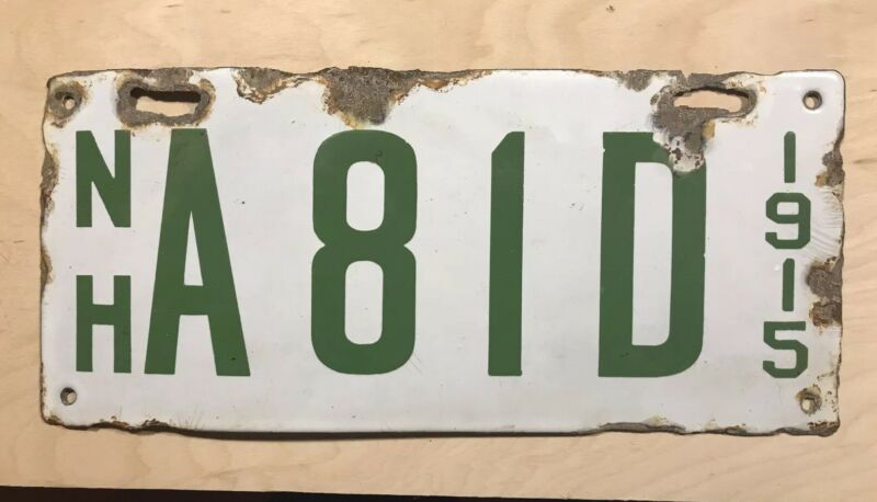 1915 New Hampshire Porcelain Dealer License Plate.