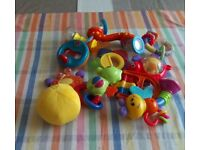 Eleven different baby rattles, including rattle ball, ring rattle, tortoise, many other designs.