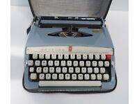 VINTAGE 1960s BLUE MANUAL BROTHER DE LUXE PORTABLE TYPEWRITER IN ORIGINAL CASE & CARE INSTRUCTIONS