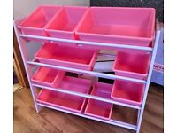 Pink storage shelves with containers