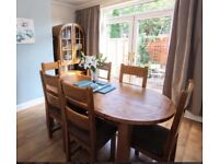 Solid oak extendable oval dining table and chairs with/ without display case.