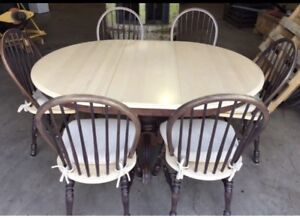Solid wood table with 6 chairs. $100.