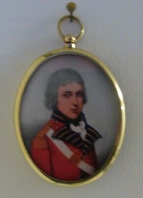 Portrait Miniature of young officer wearing red coat in oval brass frame