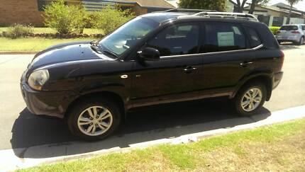 2009 Hyundai Tucson - Black JM City SX Wagon 5dr Man 5sp 2.0i