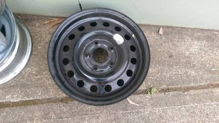 "14"" BLACK PAINTED RIM. COMMODORE STUD PATTERN. POSITIVE OFFSET. S"