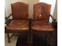 Pair leather and wood armchairs. Ralph Lauren look. Very chic.