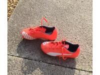 Kids size 11 football shoes