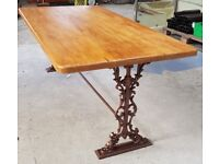 Rustic dining table with cast iron legs