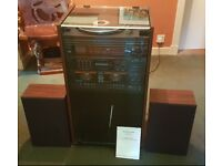 Record player in great full working condition. Has radio, twin cassettes, 2 loudspeakers & storage.