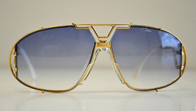 ccd29654ad87 Cazal Vintage Sunglasses - NOS - Model 907   1 - Col.332- Gold   White