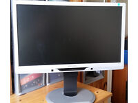 """A used but still in excellent condition Philips 21"""" LED computer monitor with buil-in speakers"""